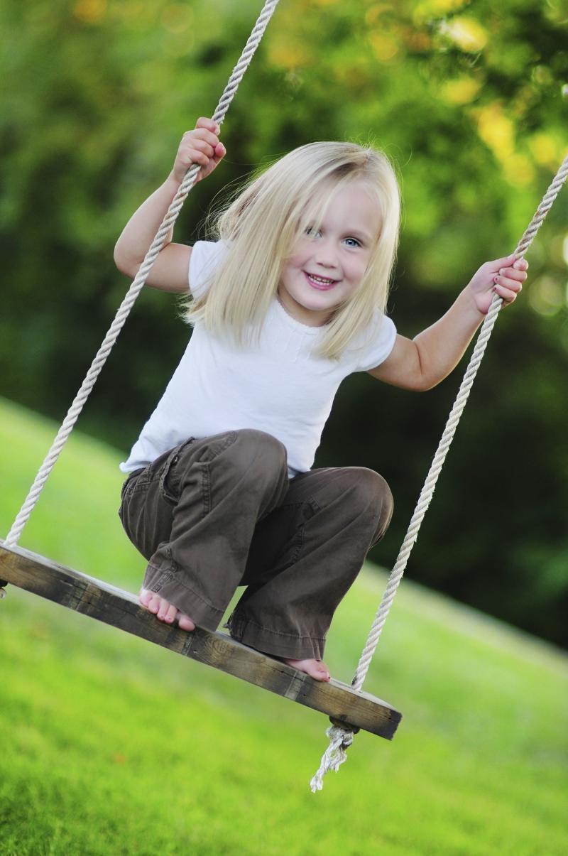 blonde girl on swing
