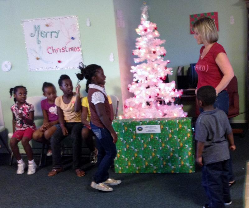 Children who attend the After School Program at Clare House of Catholic Charities receive gifts from the Angel Tree Program.
