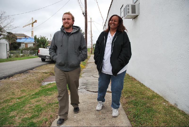 David Eber walks with a client in the Lower 9th Ward