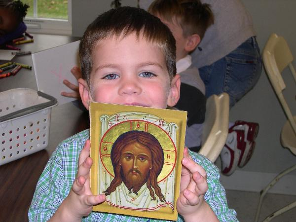 Child with icon