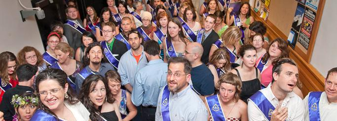 Graduates with Naropa sashes