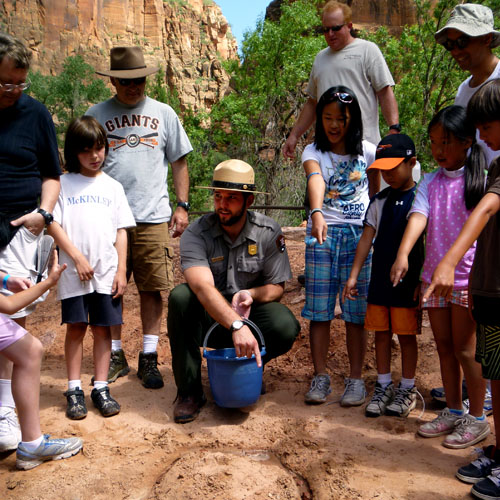 Zion Ranger with Children Learning Geology