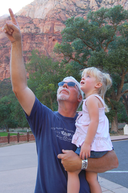Grandfather points out features of Zion to young Granddaughter.