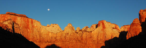 As the moon goes down the sun comes up in Zion National Park