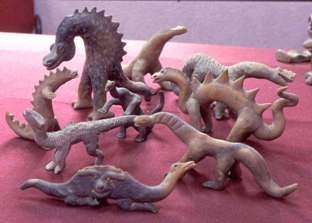 2500 YEAR OLD CLAY FIGURINES OF DINOSAURS FOUND.