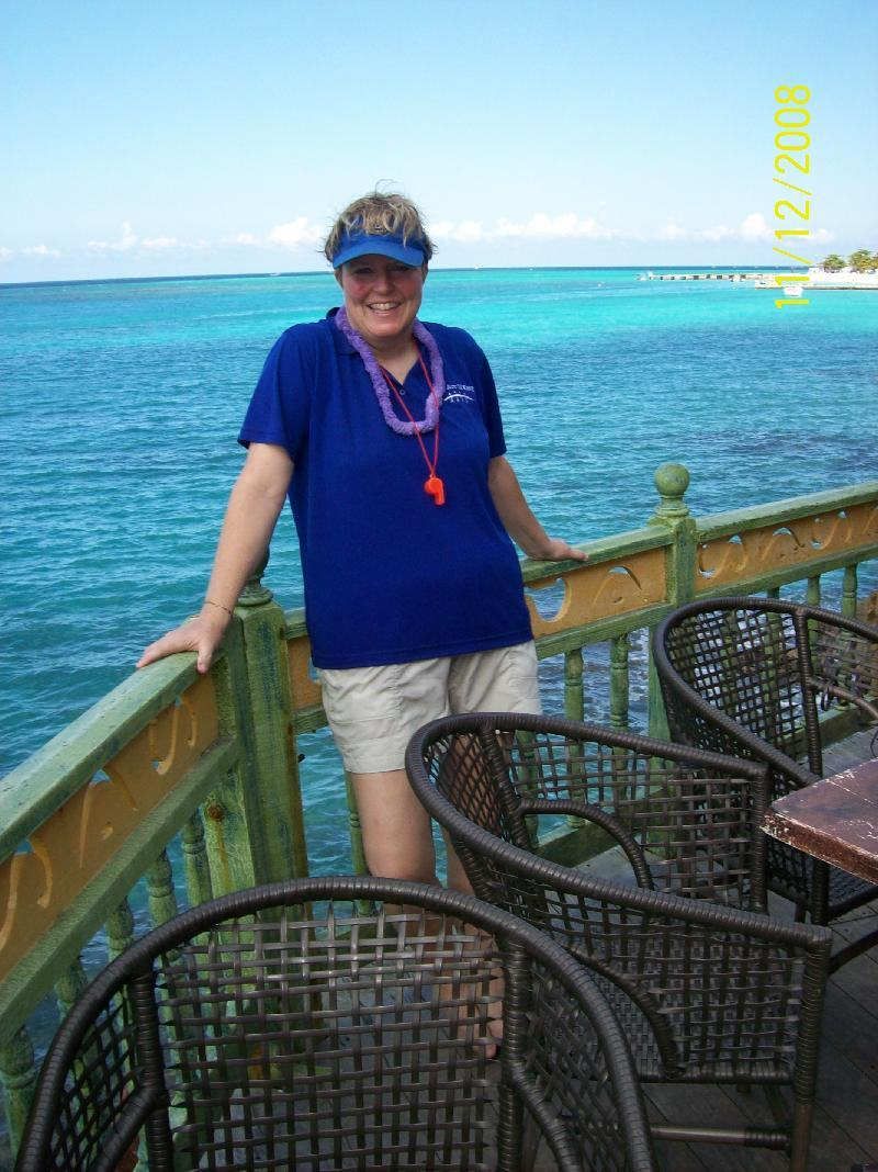 Amy in Jamaica wearing Arc of Katy shirt.  Blue water in background.