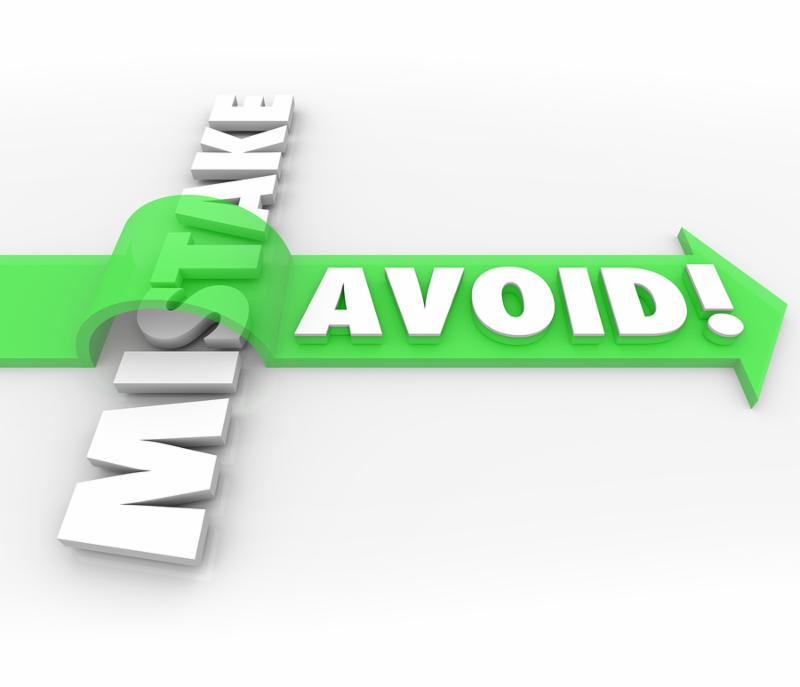 Avoid Mistake words in 3d letters and a green arrow over the word to illustrate preventing a problem, error, difficulty or inaccuracy