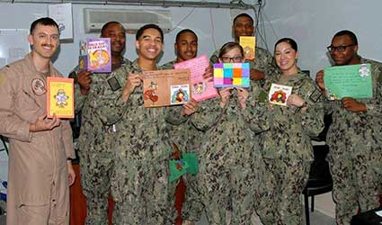 US Navy display Thanksgiving cards from Mercy students.