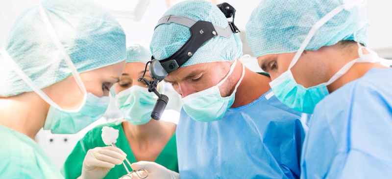 Hospital - surgery team in the operating room or Op of a clinic operating on a patient, perhaps it s an emergency