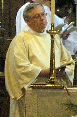 Deacon Givler at the Altar
