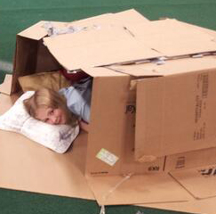 Girl in Box at Youth Homeless Event