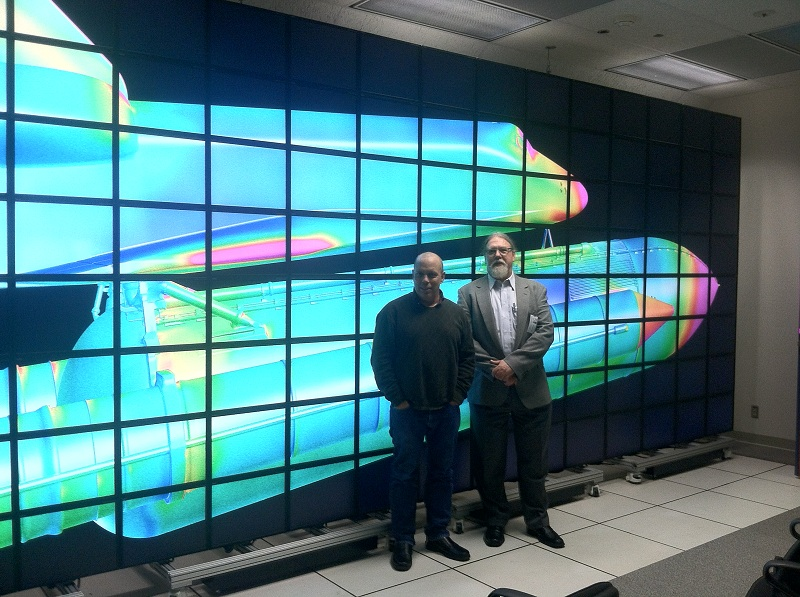 Intelligent Light's Steve Legensky with NASA Ames' Tim Sandstrom stand in front of NASA's Hyperwall during FieldView 14 preview