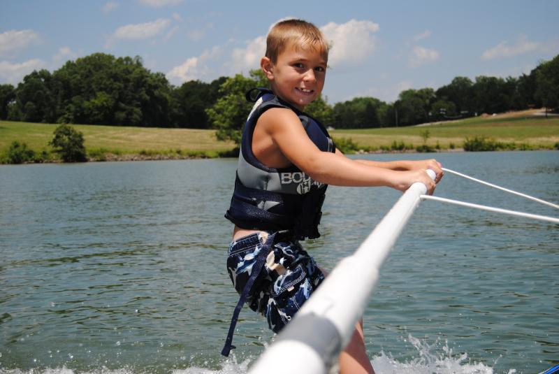 Boy water skiing at Camp John Knox