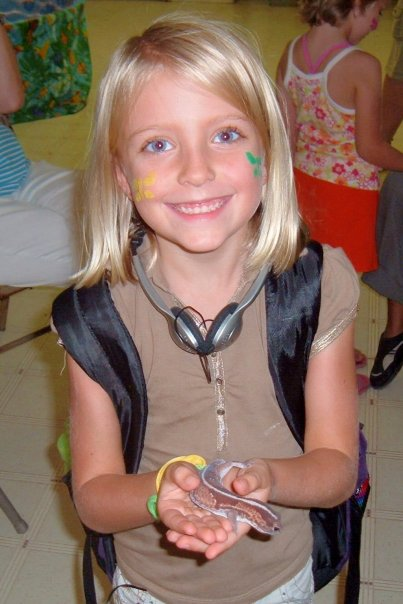 Girl with snake from the Nature Center at John Knox Center