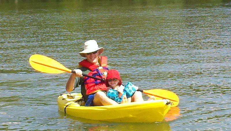 Man and child in kayak at John Knox Center