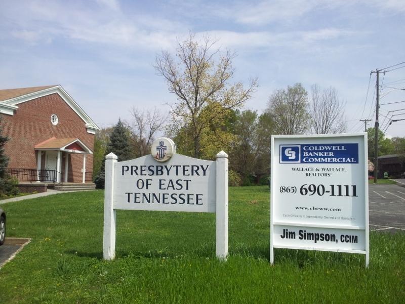 Presbytery building with realtor sign
