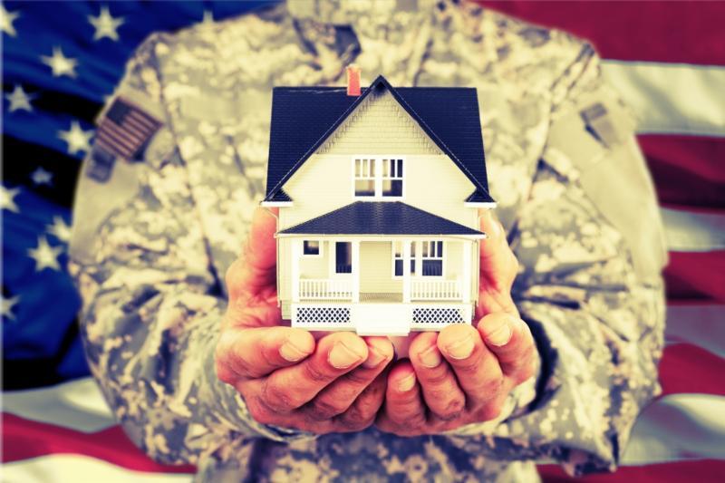 Veteran holding a house