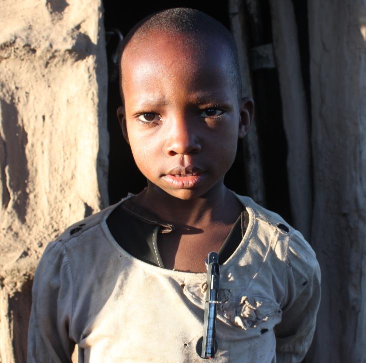 Maasai boy with CO monitor
