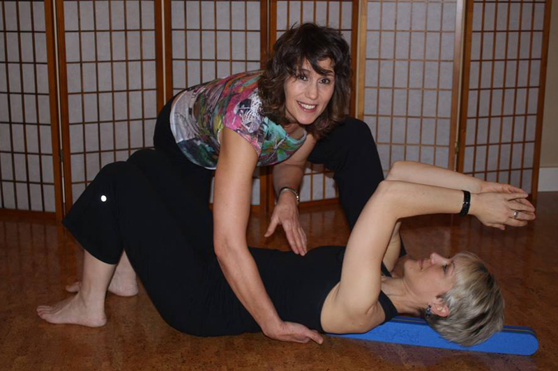 Sharon Abbondanza teaching restorative yoga with the BackMitra