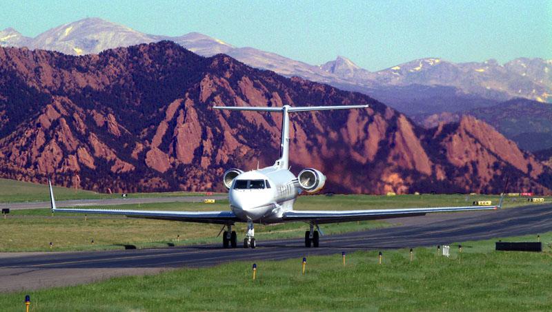 Plane landing at Rocky Mountain Metropolitan Airport