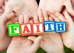 Hands Holding FAITH Blocks
