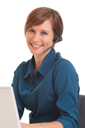 Red Headed Woman in Blue Blouse at Computer