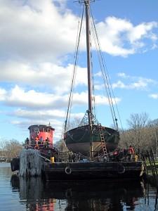 Sloop on Barge