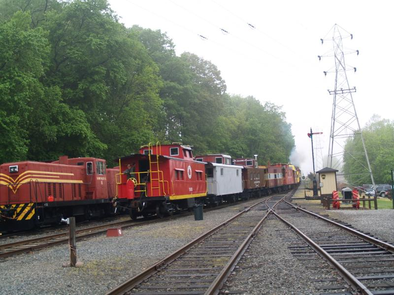 Caboose train leaving the station