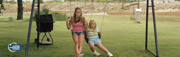 Girls on swingset in Treece