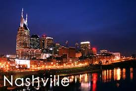 "A view of a cityscape with the word ""Nashville"" in front."