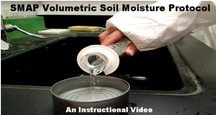 A screen grab of a video player showing someone pouring water into a can.