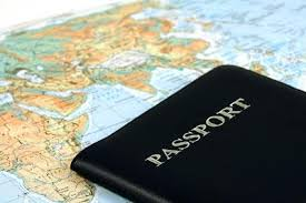 Photo of a passport and a map