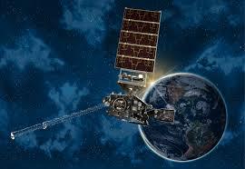 A spacecraft is seen near Earth.