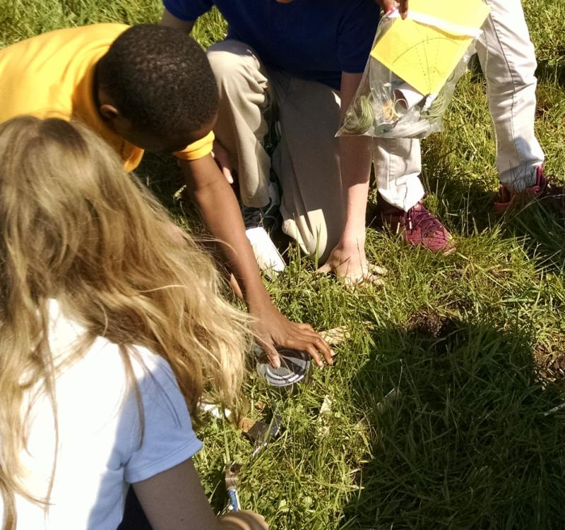 Several students work together to take soil samples.