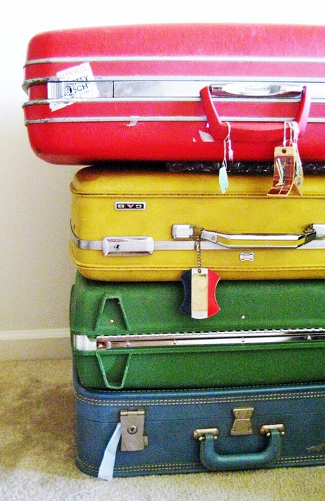 Photo of a stack of suitcases.