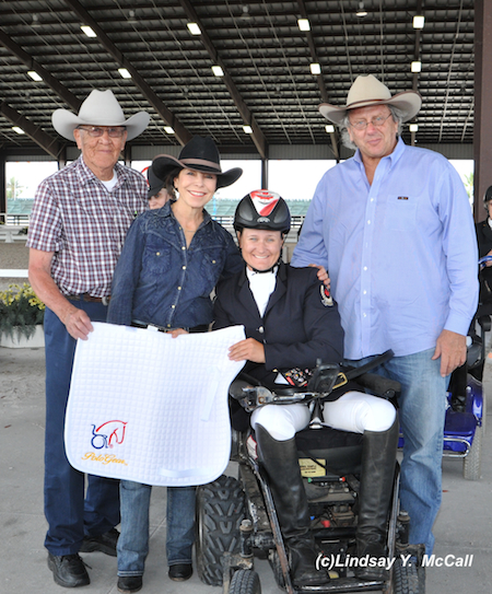 Lauren Barwick (CAN) Two -Time Paralympian, Grade II, at the Adequan Global Dressage Festival CPEDI3*. Barwick earned the high point award for Para-Dressage. Also pictured (Left to right) Newton Oldcrow, Jeanette Sassoon, and Gary Fellers of Polo Gear. Photo by Lindsay McCall.