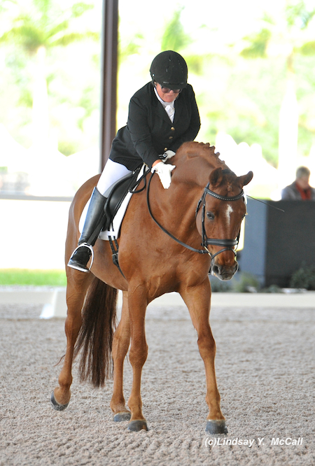 Ellie Brimmer (USA) Grade III and London Swing celebrating their ride. Photo by Lindsay McCall