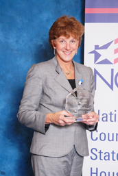 NJHMFA's Marge Della Vecchia holds the 2009 Award for Program Excellence