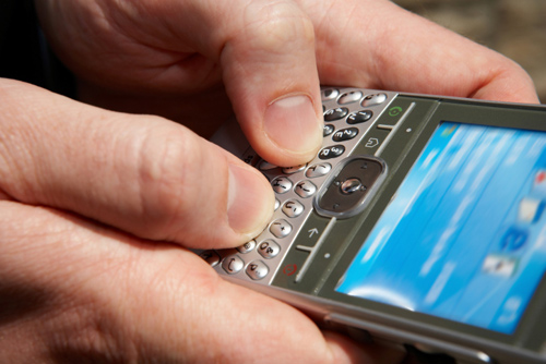 close up of Blackberry smartphone in use