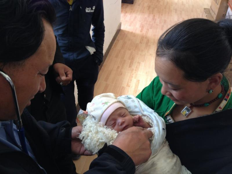Newborn, mother and Dr. Ngagay at Rima Clinic