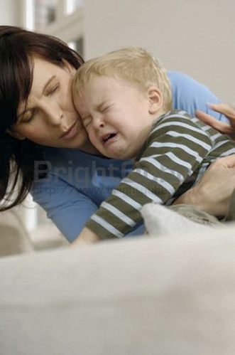 mother comforting crying child