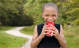 boy with coca cola soda