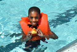 child in lifejacket in pool