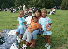 family attending summer concert