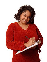 lady in red with a pen and pad of paper