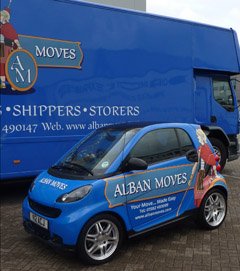 Smart Car and removal lorry