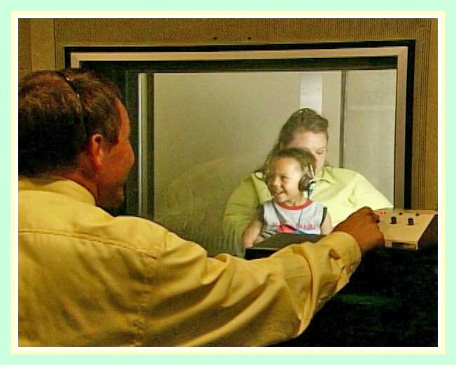Audiologist assessing child