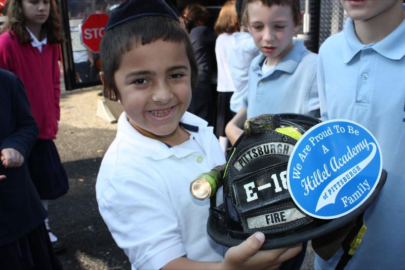 Student with Fire Hat and Hillel Magnet