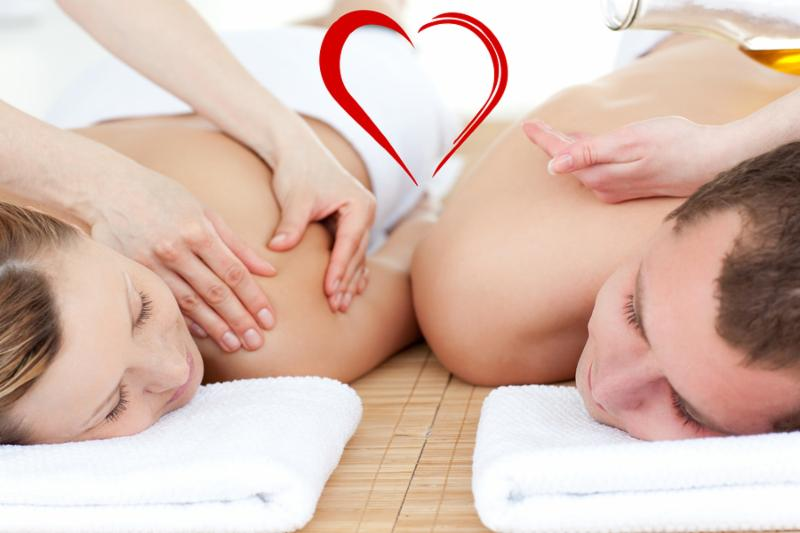 Relaxed couple receiving a back massage against heart