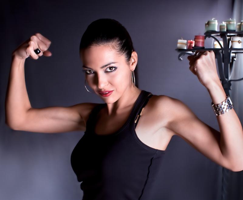 Beautiful woman show your biceps  , studio shot